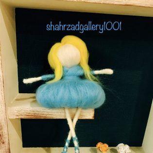 عروسک الیافی زرد و آبی